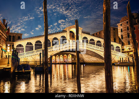 The Rialto bridge, night view from the wharf of gondolas - Stock Photo