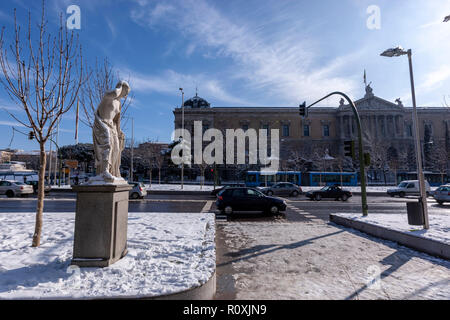 Statue known as Mariblanca with snow in Paseo de Recoletos and the Spanish National Library, Madrid, Spain - Stock Photo