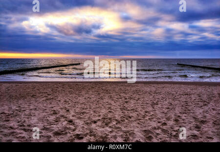 Sunset on the beach in Ahrenshoop in Mecklenburg-Western Pomerania on the peninsula Fischland-Darss-Zingst on the Baltic Sea. - Stock Photo