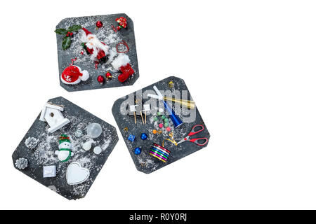 Accessories, Preparing for Christmas. Holiday decoration on three late squares, toys, garlands, on white, ,top view - Stock Photo