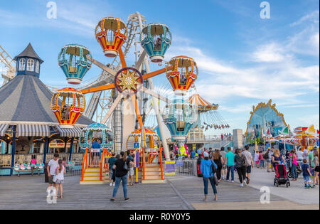 An amusement park with rides at the ocean shore. - Stock Photo