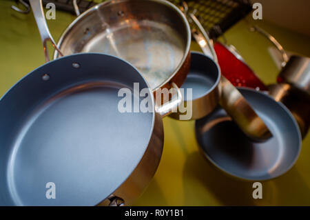 Decorative hanging pots and pans home kitchen display - Stock Photo