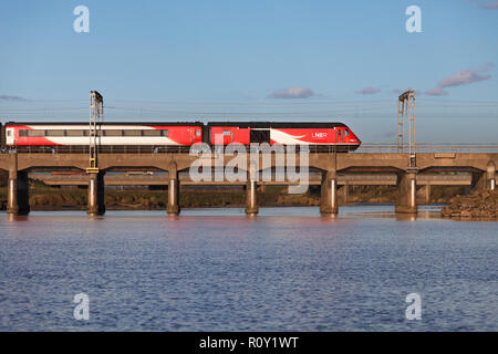 A London North eastern railway Intercity 125 crossing river Esk at Mossband, north of Carlisle with a train diverted due to engineering work - Stock Photo