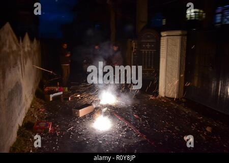 November 7, 2018 - Srinagar, J&K, India - People are seen burning fire crackers on the eve of Diwali during the Hindu festival of lights, in Srinagar, Indian administered Kashmir.Diwali, also known as the festival of lights is a Hindu festival celebrated in autumn season every year. The celebration of the festival spiritually signifies the victory of light over darkness and good over evil and commemorates the Hindu God, Lord Rama's return to his kingdom Ayodhya. Credit: Saqib Majeed/SOPA Images/ZUMA Wire/Alamy Live News - Stock Photo