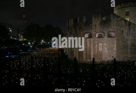London, UK. 7th Nov, 2018. Photo taken on Nov. 7, 2018 shows the installation called 'Beyond the Deepening Shadow: The Tower Remembers' at the Tower of London in London, Britain. This installation is part of a nationwide series of events to commemorate the 100th anniversary of the end of World War I. Credit: Han Yan/Xinhua/Alamy Live News Stock Photo