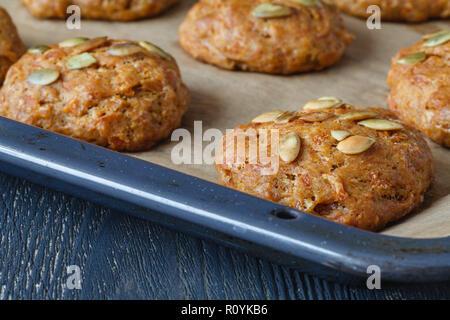 close up pumpkin cookies with seeds - Stock Photo