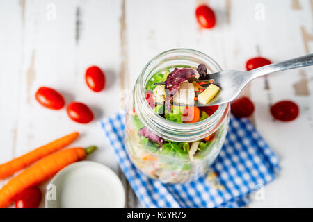 Top view of healthy salad in a jar - Stock Photo