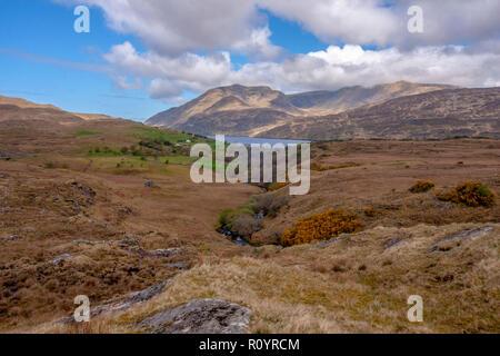 Landscape County Galway looking across Killarey Harbour to Mweelrea in County Mayo. - Stock Photo