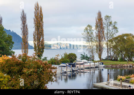 View across Lake Taupo from Kinloch marina on shores of Whangamata Bay, Lake Taupo, North Island, New Zealand - Stock Photo