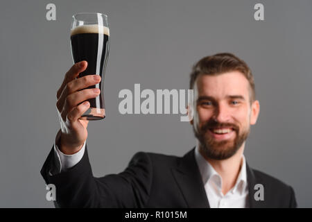 Beer glass in man's arms - Stock Photo