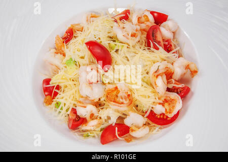 delicious shrimp and tomato salad with marinated feta cheese and toast, isolated background - Stock Photo