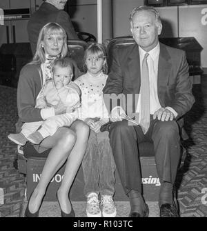 Racehorse owner and breeder Robert Sangster with wife Susan Lilley and two children  leaving Heathrow in February 1988 - Stock Photo