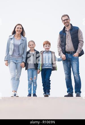 blurred image of a family with two children - Stock Photo