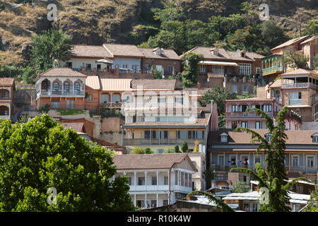 Colorful traditional houses with wooden carved balconies in the Old Town of Tbilisi, Georgia - Stock Photo