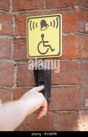 Call button for the disabled built-in wall marked yellow tablets - Stock Photo