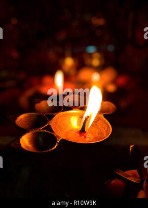 Colourful diyas and lamps on the night of Diwali festival during the prayer - Stock Photo