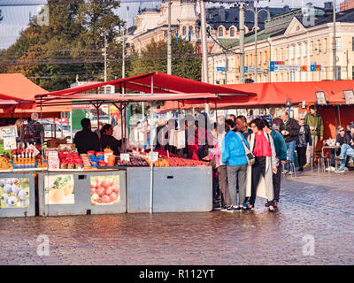 20 September 2018: Helsinki, Finland - Crowd of Asian tourists at a fruit stall in the Farmer's Market. - Stock Photo