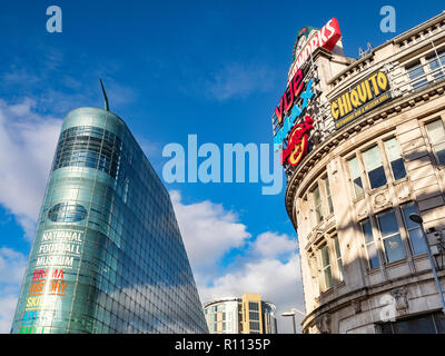 2 November 2018: Manchester, UK -  The Urbis building, home of the National Football Museum, and The Printworks, an entertainment venue, in Exchange S - Stock Photo