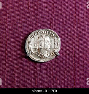 Man's profile on ancient coin - Stock Photo