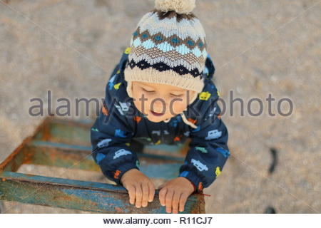 High angle view of a cute boy wearing a woolly hat - Stock Photo