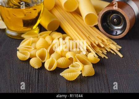 Italian foods concept and menu design, spaghetti. Various kind of Pasta on a black background - Stock Photo