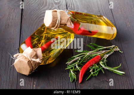Oil Bottles with Aromatic Herbs - Stock Photo