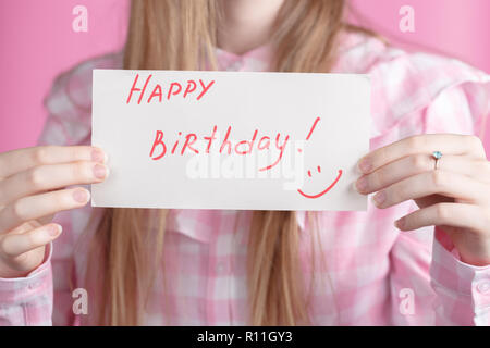 Words happy birthday and gift box in female hands - Stock Photo