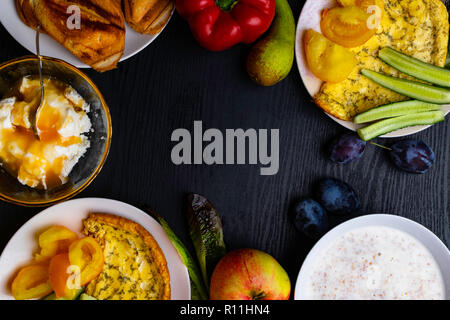 Ingredients of healthy dietary food breakfast pink grapefruit, orange, chia seeds, quinoa, green herbs, kiwi, wild rice, almond, walnuts, hazelnuts on - Stock Photo