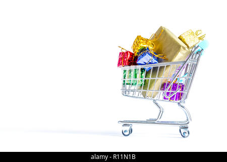 Shopping carts, trolley with boxes of colorful gifts isolated on white background - Stock Photo