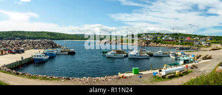 Lobster boats at the dock in Neils Harbour, Nova Scotia, Canada. - Stock Photo