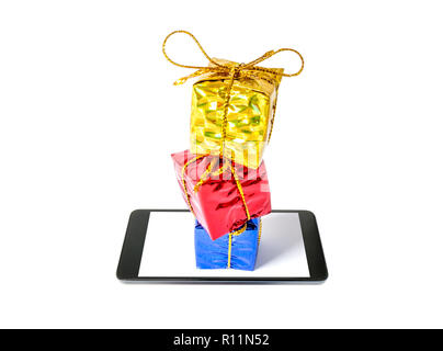 Gifts boxes in a multi-colored package bandaged with a bow stand in a column on a smartphone close-up isolated on white background. - Stock Photo