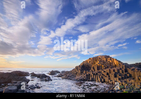 Northern Ireland, County Antrim, Giants Causeway, Dramatic cloud pattern over the rocks at sunset. - Stock Photo