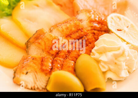 Eel fillet with vegetables on plate close - Stock Photo