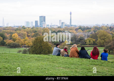 London, UK. 4th November, 2018. Members of the pubic enjoy the view from Primrose Hill on an autumn Sunday afternoon. - Stock Photo