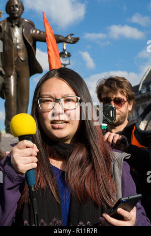 London, UK. 31st October, 2018. Lizia Wolf of Rising Up addresses environmental activists in Parliament Square for an Extinction Rebellion event. - Stock Photo