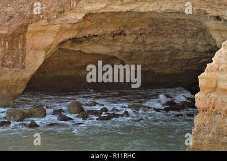 Cliff cave and sea in Carvoeiro. Algarve, Portugal - Stock Photo