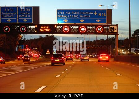 Busy rush hour traffic on the M25 motorway at dusk from a drivers point of view,Surrey England UK - Stock Photo