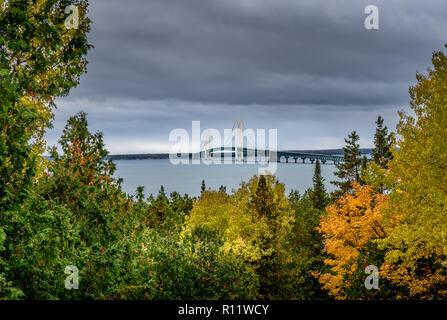 Scenic Mackinac Bridge shot from Straits State Park during the fall - Stock Photo