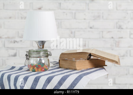 Old books in home interior - Stock Photo