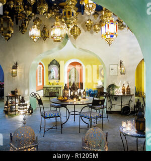 Arabic style dining table; chairs and lanterns - Stock Photo
