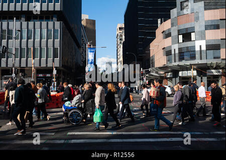 11.05.2018, Sydney, New South Wales, Australia - People are seen crossing a street in Sydney's central business district. - Stock Photo