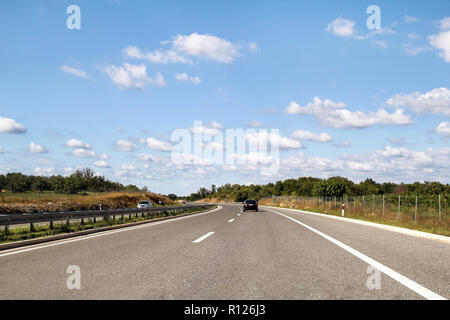 Scenic view on highway road leading through in Istria, Croatia, Europe / Beautiful natural environment, sky and clouds in background / Transport. - Stock Photo