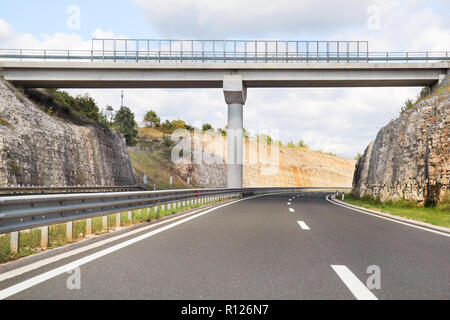 Scenic view on overpass and highway road leading through in Croatia, Europe / Beautiful natural environment, sky and clouds in background / Transport. - Stock Photo
