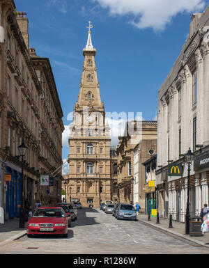 Sunny summer view of the tower and steeple of Halifax Town Hall in West Yorkshire seen from Cornmarket - Stock Photo
