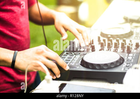 Dj mixing, Deejay playing music mixer audio outdoor - Concept of summer events and club outdoor - Stock Photo