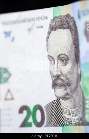 New banknote denomination of 20 UAH. Ukrainian money close up. Fragment of banknotes - Stock Photo