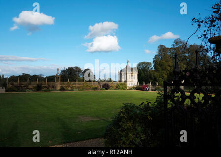 Montacute House Montacute South Somerset. The gardens showing one of two Angle Houses and the quadrangle walls to the west and south - Stock Photo