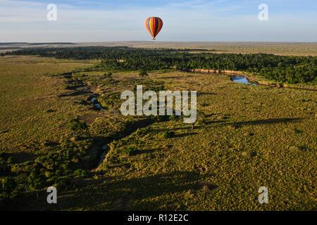 Air balloon floating over Mara River, Kenya - Stock Photo