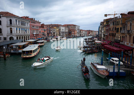 Venice / Italy - November 3rd 2018: Looking downstream from the Rialto bridge in Venice, Italy along the Grand Canal flanked by historic buildings.