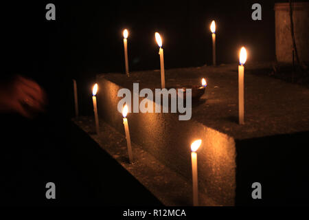 Candles on isolated black background. Flame candles lamps for the evening prayers, Religious faith believe concept. - Stock Photo